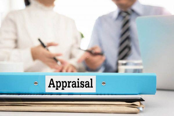 Blue-appraisal-folder-with-meeting-in-background-600x401
