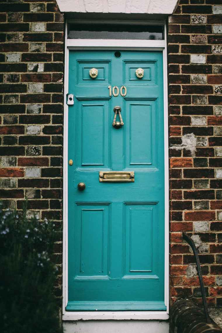 teal wooden panel door